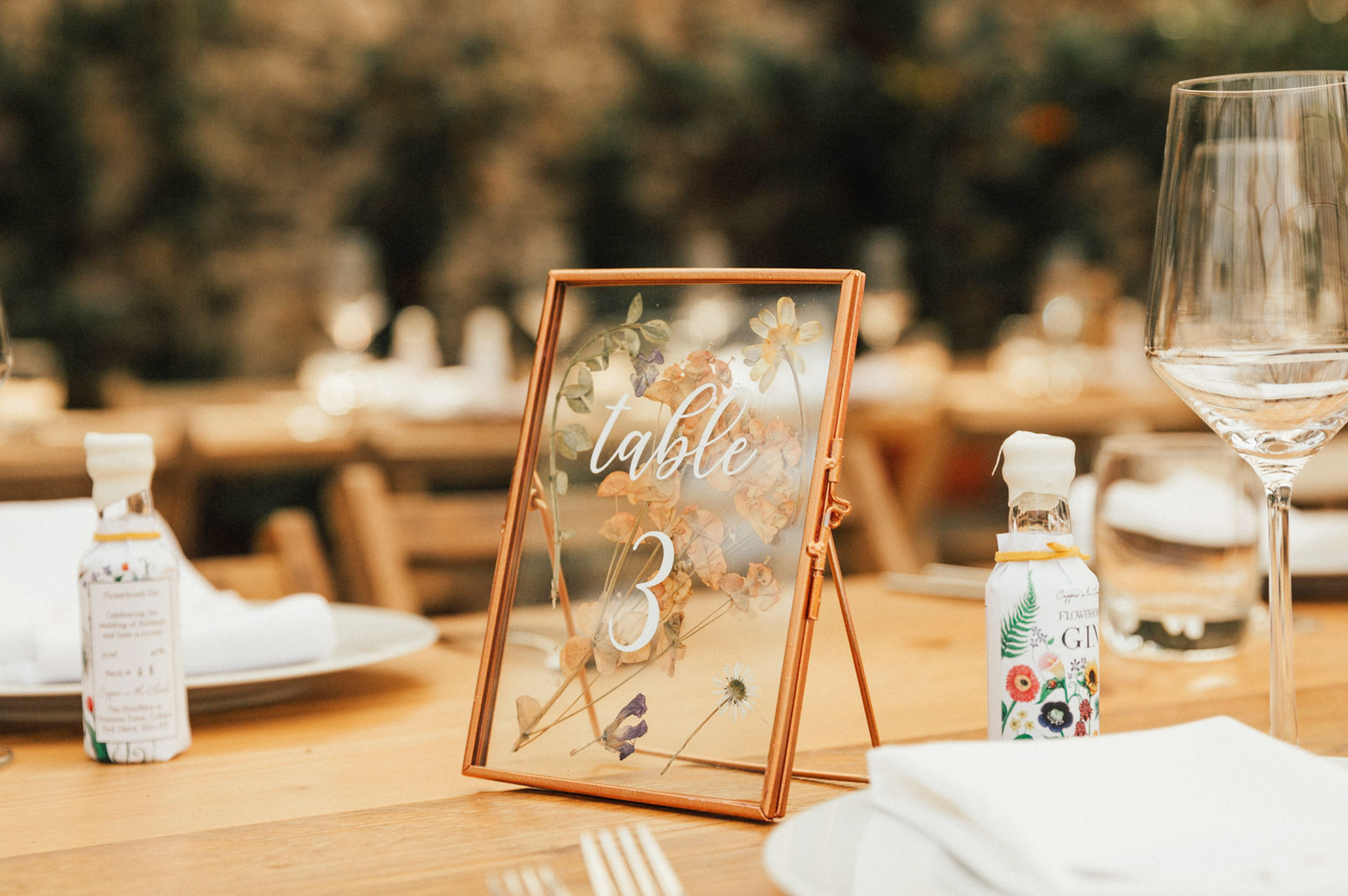 Personalised Gin favour on wedding table setting